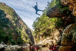 Cliff jumping in the Storms River Gorge