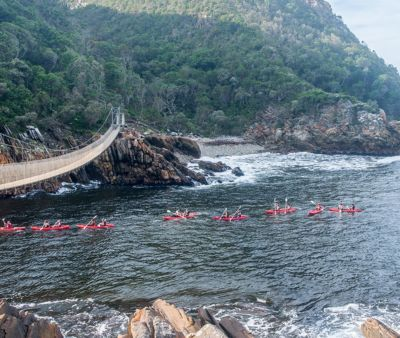 Kayaking under the Storms River Suspension Bridge